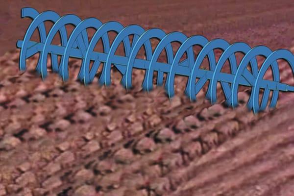 rouleau qui brise des mottes de terre